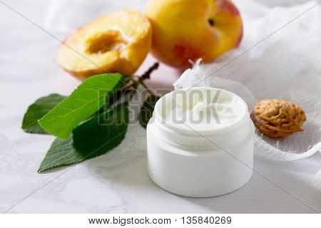 Face Cream With Peach On A Gray Stone Background - Beauty Salon.