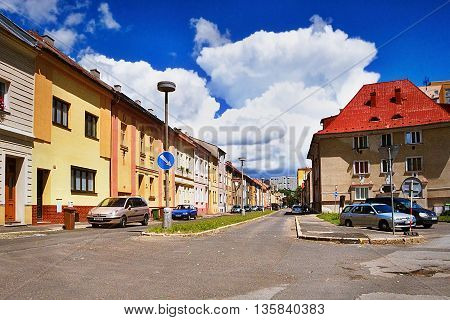 2016/06/18 - Chomutov city Czech republic - nice dark blue sky with large white clouds above the houses of in the street 'Safarikova ulice' before the planned reconstruction