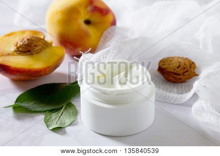 Face Cream With Peach On A Gray Stone Background - Beauty Salon. Space For Your Text.