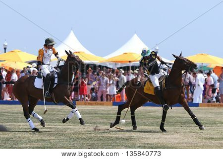 JERSEY CITY, NJ-MAY 30: Rico Mansur (R) handles the ball as Edward Hartman gives chase during a polo match at the Veuve Clicquot Polo Classic at Liberty State Park on May 30, 2015 in Jersey City, NJ.