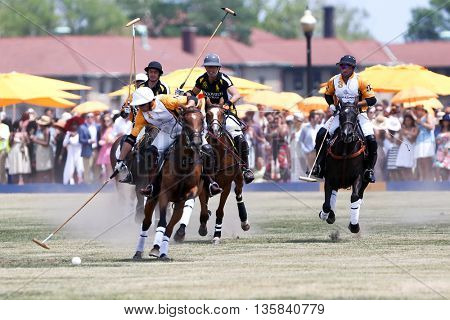 JERSEY CITY, NJ-MAY 30: Gonzalo Garcia Del Rio handles the ball as Nacho Figueras (C) gives chase at the Annual Veuve Clicquot Polo Classic at Liberty State Park on May 30, 2015 in Jersey City, NJ.
