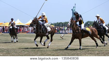 (L-R) Francisco Lanusse, Gonzalo Garcia Del Rio, Nacho Figueras & Marcos Garcia Del Rio during a polo match at the Veuve Clicquot Polo Classic at Liberty State Park on May 30, 2015 in Jersey City, NJ.