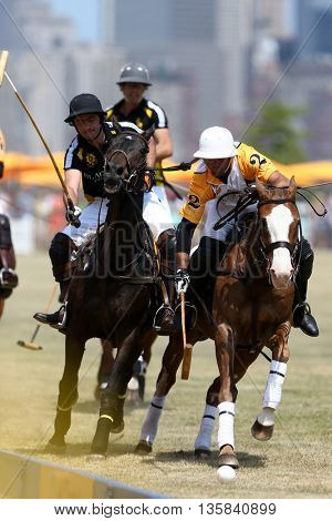 JERSEY CITY, NJ-MAY 30: Javier Tanoira (L) and Marcos Garcia Del Rio Figueras chase the ball during the Veuve Clicquot Polo Classic at Liberty State Park on May 30, 2015 in Jersey City, NJ.