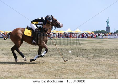 JERSEY CITY, NJ-MAY 30: Nacho Figueras handles the ball during a polo match at the 8th Annual Veuve Clicquot Polo Classic at Liberty State Park on May 30, 2015 in Jersey City, NJ.