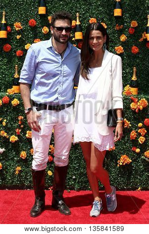 JERSEY CITY, NJ - MAY 30: Rico Mansur (L) and Fernanda Motta attend the 8th Annual Veuve Clicquot Polo Classic at Liberty State Park on May 30, 2015 in Jersey  City, New Jersey.
