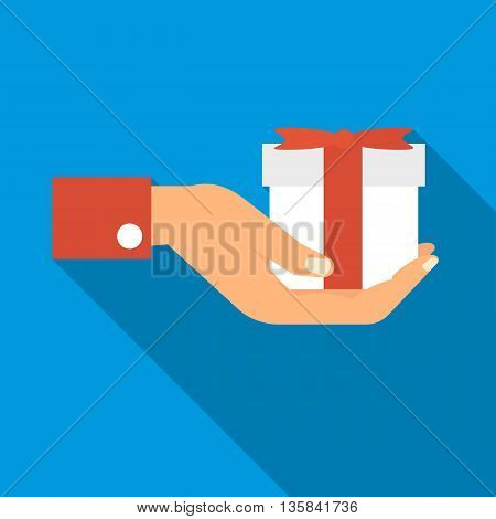 Hand holding a gift icon in flat style with long shadow. Holidays and gifts symbol