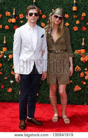 JERSEY CITY, NJ - MAY 30: Model Andreja Pejic (R) and Justin Oates attend the 8th Annual Veuve Clicquot Polo Classic at Liberty State Park on May 30, 2015 in Jersey  City, New Jersey.