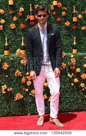 JERSEY CITY, NJ - MAY 30: Model Johannes Huebl attends the 8th Annual Veuve Clicquot Polo Classic at Liberty State Park on May 30, 2015 in Jersey  City, New Jersey.