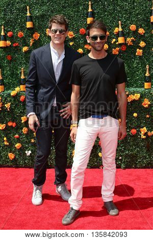 JERSEY CITY, NJ - MAY 30: Designer Wes Gordon and Paul Arnhold attend the 8th Annual Veuve Clicquot Polo Classic at Liberty State Park on May 30, 2015 in Jersey  City, New Jersey.