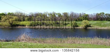Panoramic landscape river sunny summer sultry day