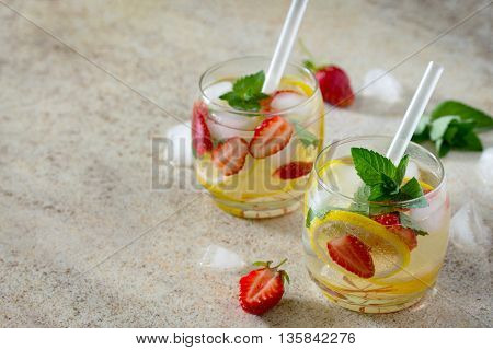 Tradition Summer Mojito Drink With Lemon And Mint With Copy Space On Brown Stone Background.