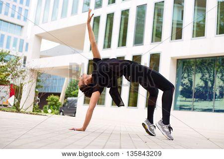 dancer in the street bent backwards pose
