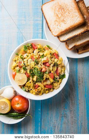 Masala Anda Bhurji of egg bhurji or Spicy scrambled eggs with bread or pav or paav slices and salade, anda bhurji paav