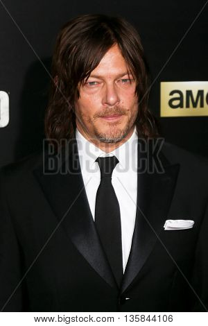 NEW YORK-OCT 9: Actor Norman Reedus attends AMC's 'The Walking Dead' season six premiere at Madison Square Garden on October 9, 2015 in New York City.