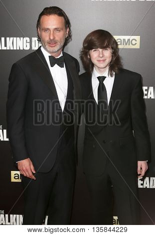 NEW YORK-OCT 9: (L-R) Actors Andrew Lincoln and Chandler Riggs attend AMC's 'The Walking Dead' season six premiere at Madison Square Garden on October 9, 2015 in New York City.