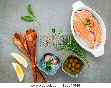 Raw Salmon Fillet In The White Bowl With Ingredients Olive Oil ,sea Salt, And Herbs Fennel ,sage ,ro