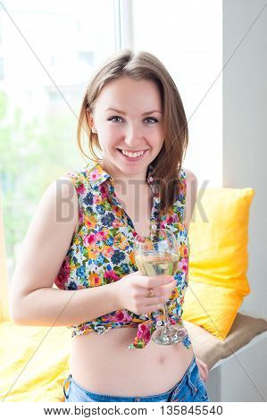 Young Beautiful Girl With Glass Of Wine