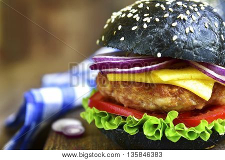 Black Burger With Meat Cutlet On A Cutting Board.rustic Style.