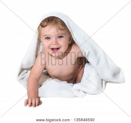 Beautiful little girl smiling under the towel
