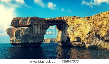 Azure Window, famous stone arch on Gozo island with reflection, Malta. Tonet photo