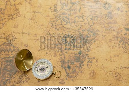 Old vintage compass on vintage map background