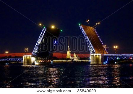 St. Petersburg, Russia, June 21, 2016: In St. Peterburg the drawbridges are opened at 1.30 am to let pass the cargo ships from the Gulf of Finland to bring their goods to cities farther up the river Neva.