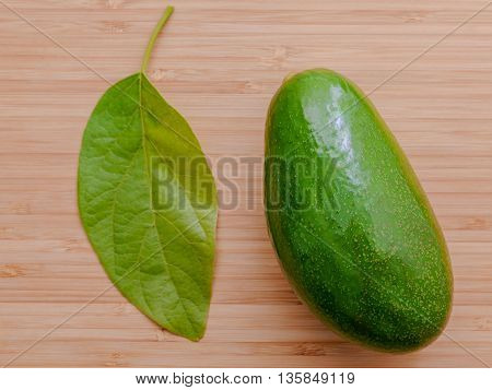 Fresh Avocado On Wooden Background. Organic Avocado Healthy Food Concept.. Avocado On Bamboo Cutting