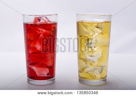 fresh juice with ice on a white background in glasses