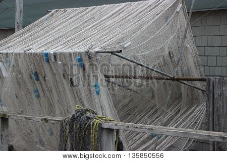 Fishing nets all wrapped up dock water boat