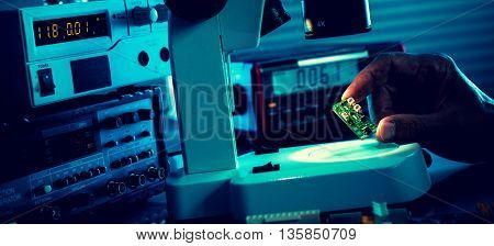 control microelectronic device in a laboratory microscope. Tonet photo