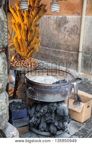 Street vendor equipment for roasting chestnuts on a charcoal
