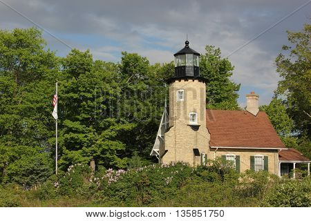 Whitehall Station Museum Lighthouse in Michigan with weather front passing thru