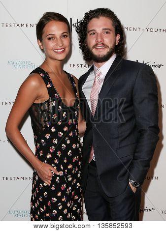 NEW YORK, NY-JUNE 2: Actors Alicia Vikander (L) and Kit Harington attend the