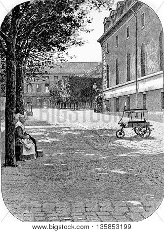 Street outside the Pitie-Salpetriere Hospital in Paris, France. Vintage engraving.