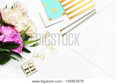 Office desktop, woman background, feminine scene, flat lay. Peonies and stationery, gold stripe pattern and polka dots.