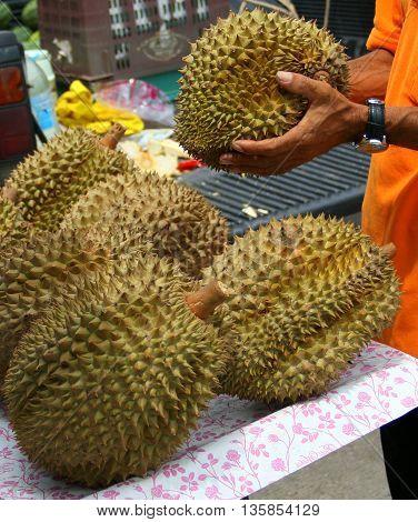 monthong durian and vendor, Ranot waterside market, Thailand