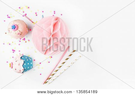 White background with party accessories. Invitation mockup. Confetti and muffins. cake
