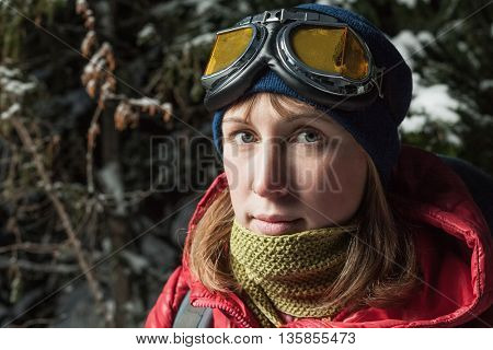 Close up portrait of young woman with goggles looking to a camera