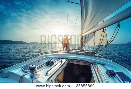 Young couple enjoying sunset on the yacht in Andaman sea