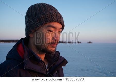 Asia man portrait with ice lake outdoor
