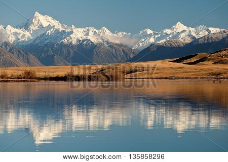 The Southern Alps Reflected in Lake Clearwater. Hakatere Conservation Park, Canterbury, New Zealand