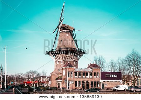 Photo of Windmill in Amsterdam Netherlands with a blue sky