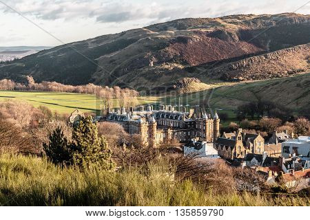Photo of Castle and mountains in Edinburgh Scotland