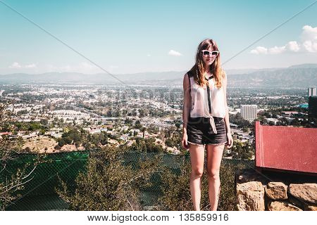 Girl At Hollywood Hills With Panoramic View Of Los Angeles