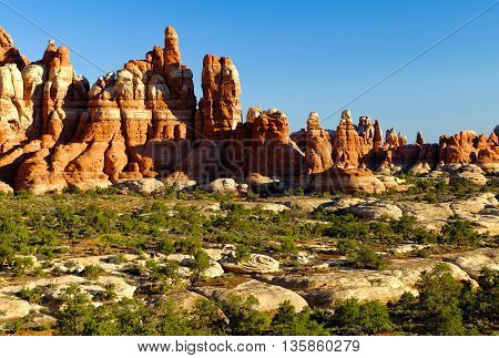 Sunrise Over Dramatic Sandstone Formations.  Chesler Park, Canyonlands National Park, Utah