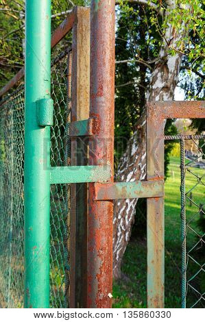 closeup of an old metal rusty fence