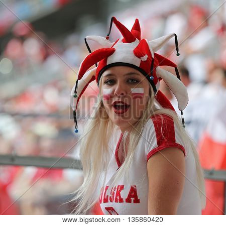 MARSEILLE FRANCE - JUNE 21 2016: Polish fan shows her support during the UEFA EURO 2016 game Ukraine v Poland at Stade Velodrome in Marseille. Poland won 1-0