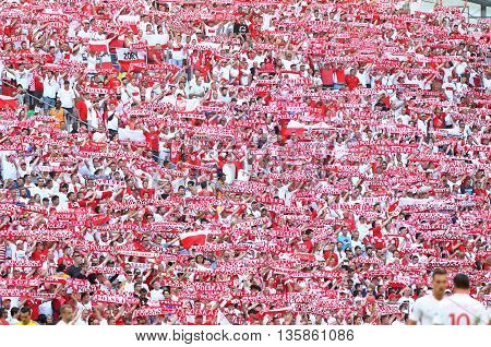 MARSEILLE FRANCE - JUNE 21 2016: Polish fans show their support during the UEFA EURO 2016 game Ukraine v Poland at Stade Velodrome in Marseille. Poland won 1-0
