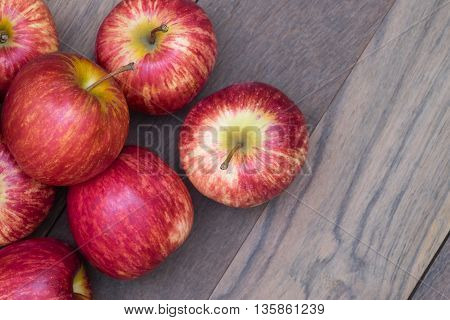 Red apples with background of wooden table.