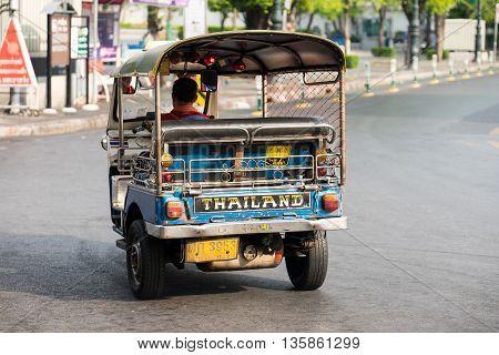 BANGKOKTHAILAND-JUNE 18 : Tuk-tuk or motor-tricycle is a popular vehicle on the roadJune 182016in BangkokThailand.